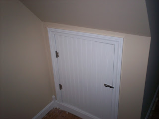 here is the closet we framed out under the stairs to make the door i