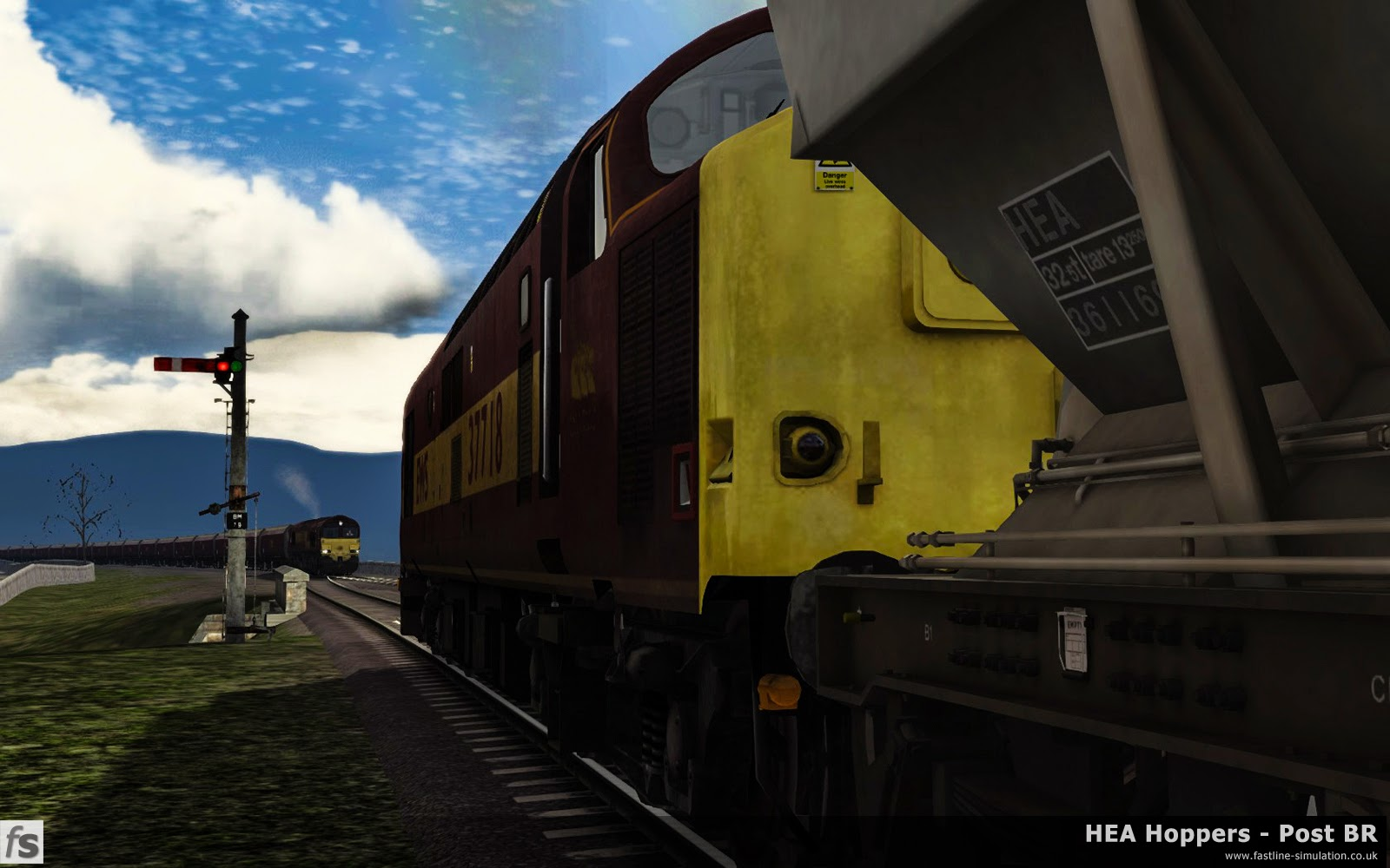 HEA Hoppers - Post BR: Class 37/7 37718 waits at the northern end of Ribblehead viaduct as a northbound empty coal train crosses. The 37 is hauling long stored HEA hoppers on their last journey to be converted into MEA mineral wagons.