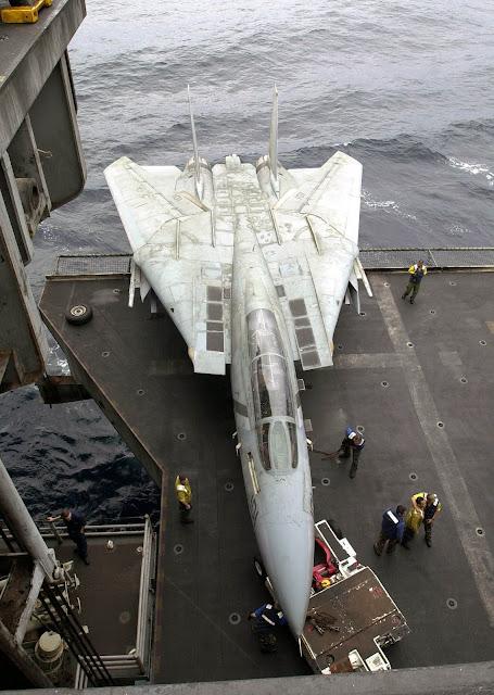 Hanger Deck Crew move a F-14D Tomcat