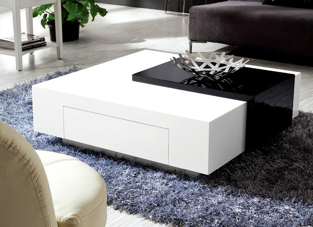 a beam white marble lacquer coffee table with beige hand tufted area rug