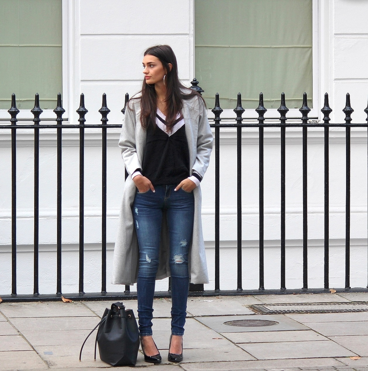 peexo fashion blogger wearing distressed denim and longline coat