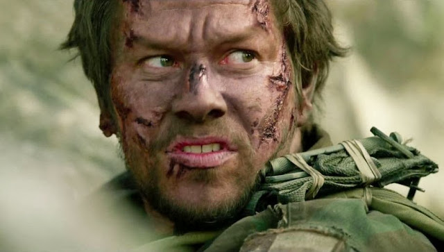 Lone survivor movie still - Mark Wahlberg as Marcus Luttrell facial injuries