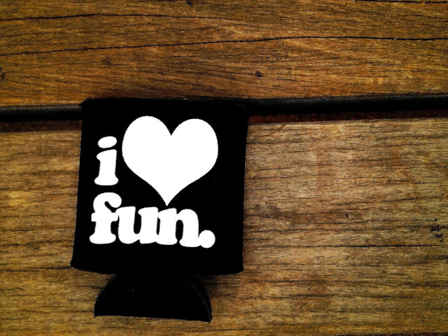 A beer koozie at a concert at Red Rocks Amphitheater that says 'I Love Fun' referring to the band Fun.