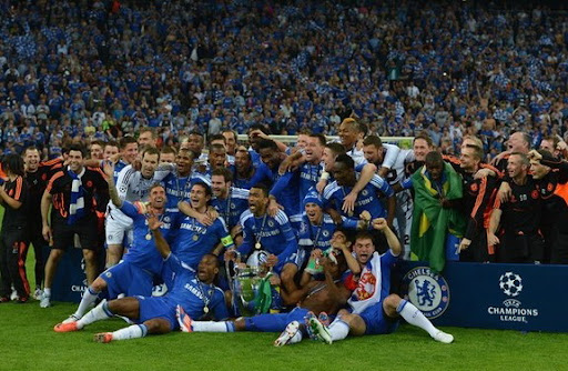 Chelsea players celebrate with the trophy after their victory in the Champions League Final