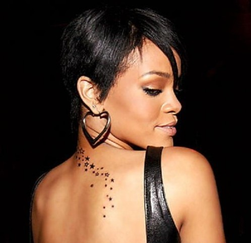 rihanna tattoos arabic. rihanna star tattoos. rihanna