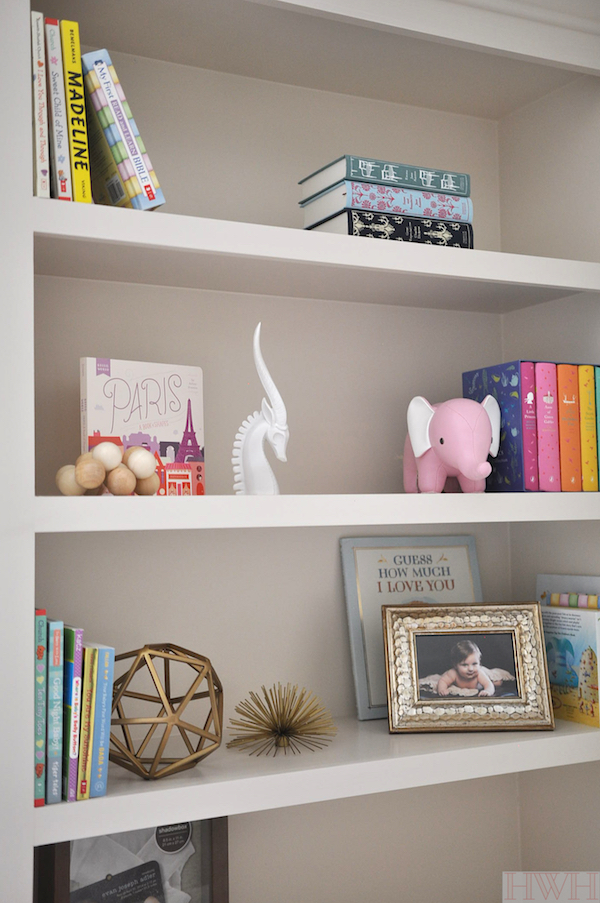 Nursery bookshelf with colorful accessories
