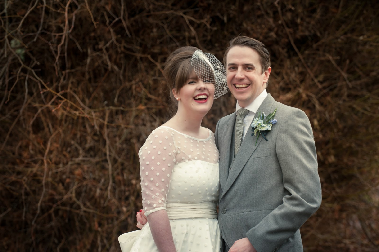 Bride and Groom laughing together at their vintage style wedding in the scottish highlands