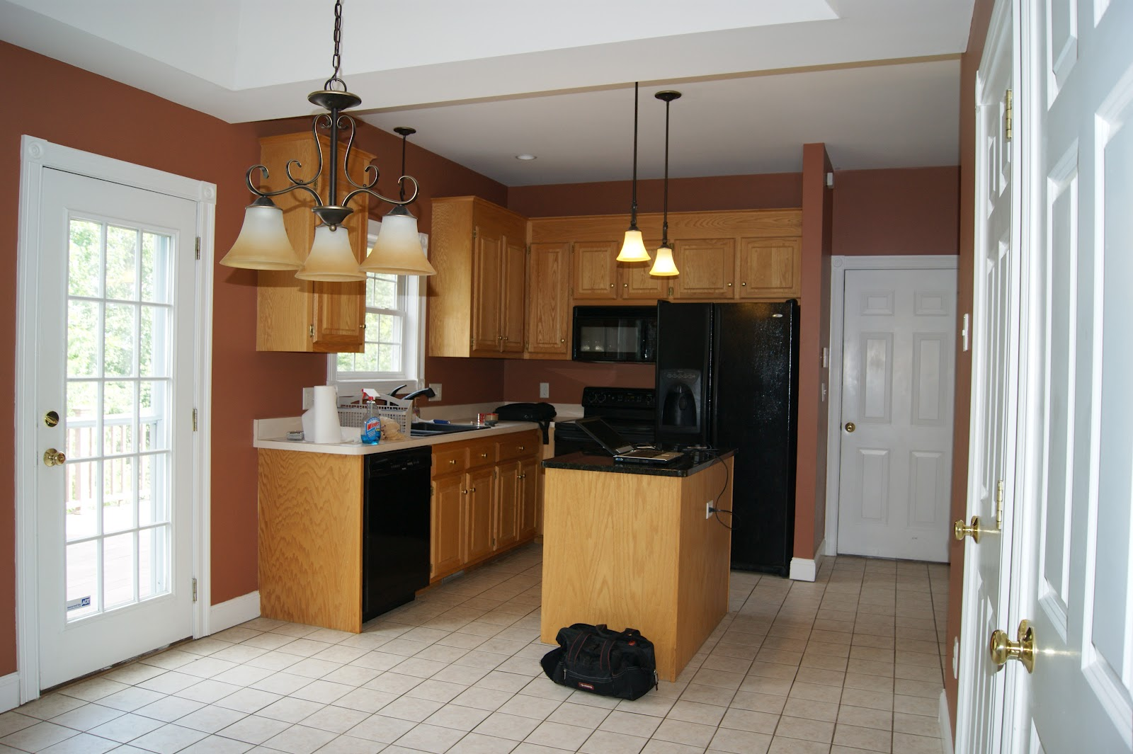 the room stylist repainting your kitchen cabinets