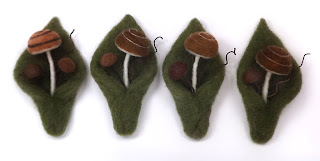 Handcrafted wool wedding boutonnieres - mushrooms and mossy leaf