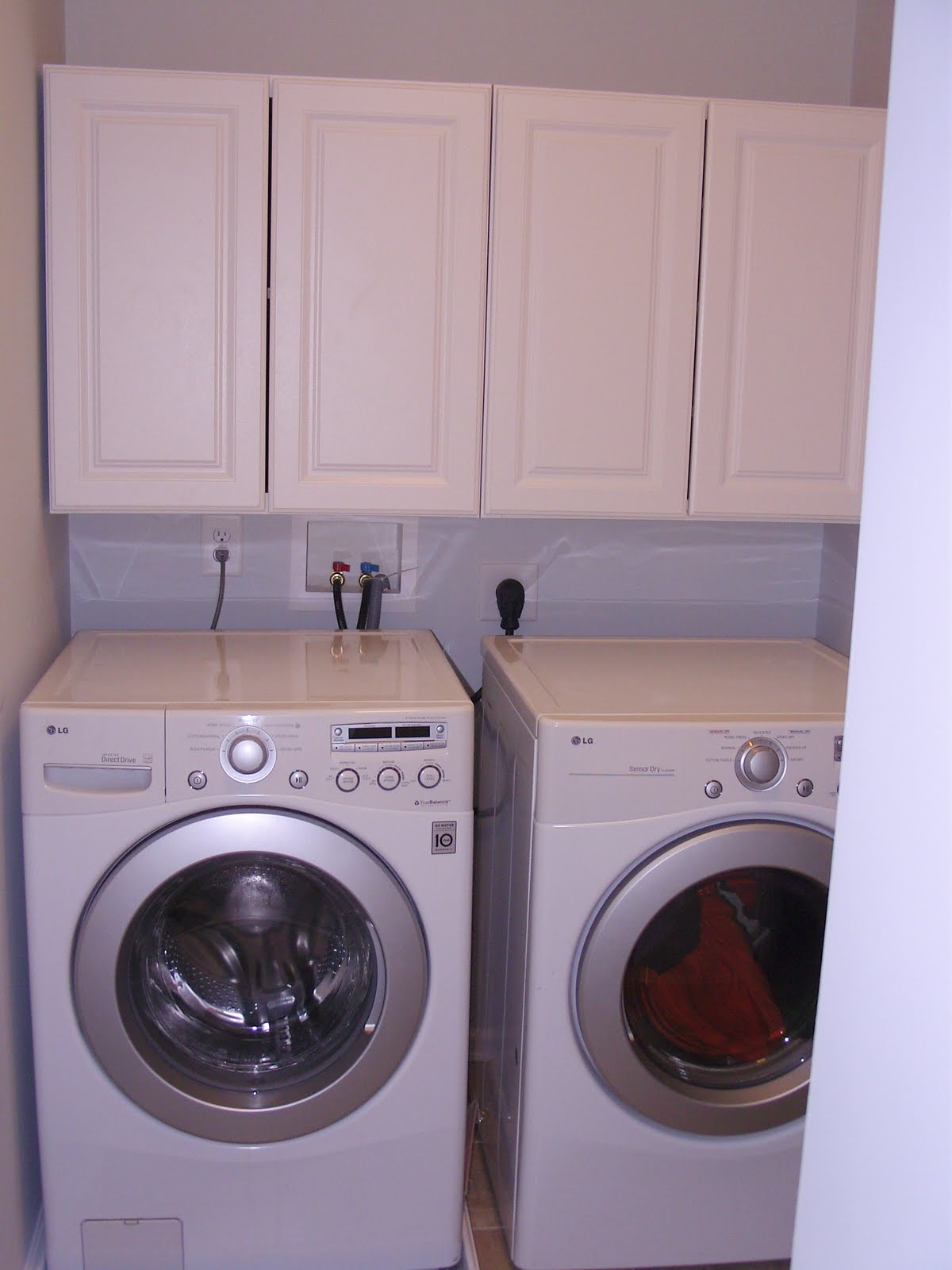 Our 1st new home building a ryan homes milan laundry for Laundry room cabinets