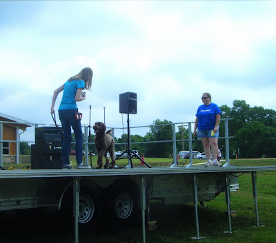 Alfie on stage with Charissa, prancing and wagging
