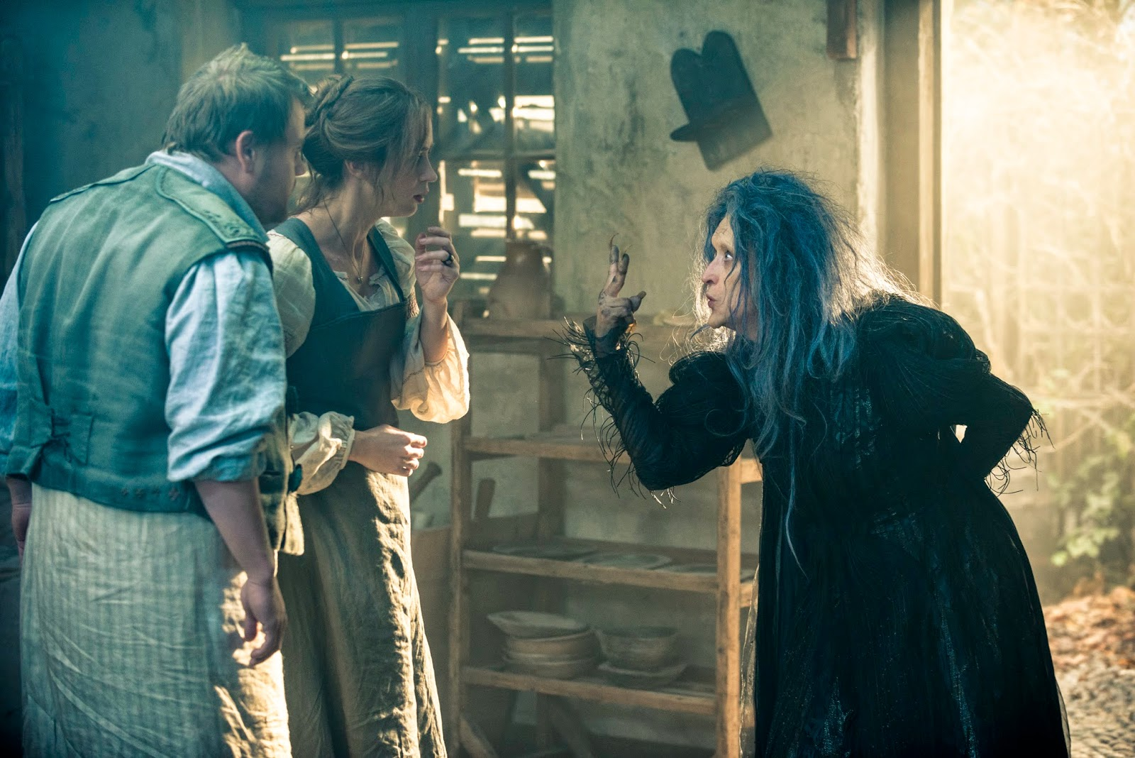 The Witch (Meryl Streep) with the Baker (James Corden) and his wife (Emily Blunt) in Into The Woods