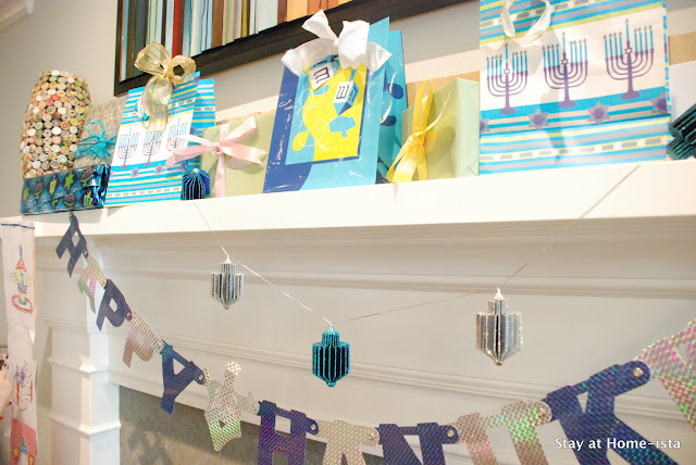 Hanukkah themed mantle with gifts