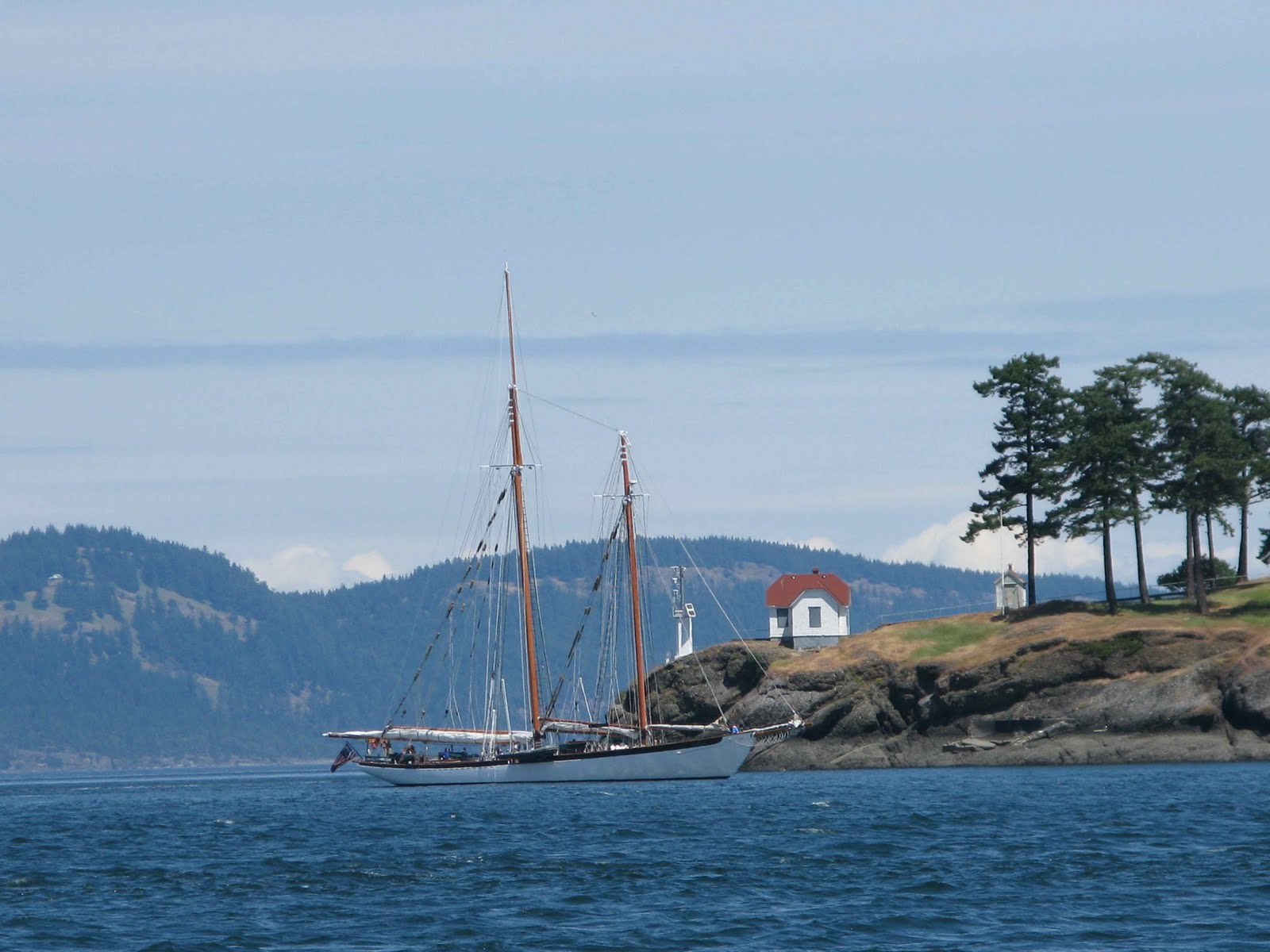Turn Pt on Stuart Island. Cupcake enters Canada with wind and 1.3 knots of ...