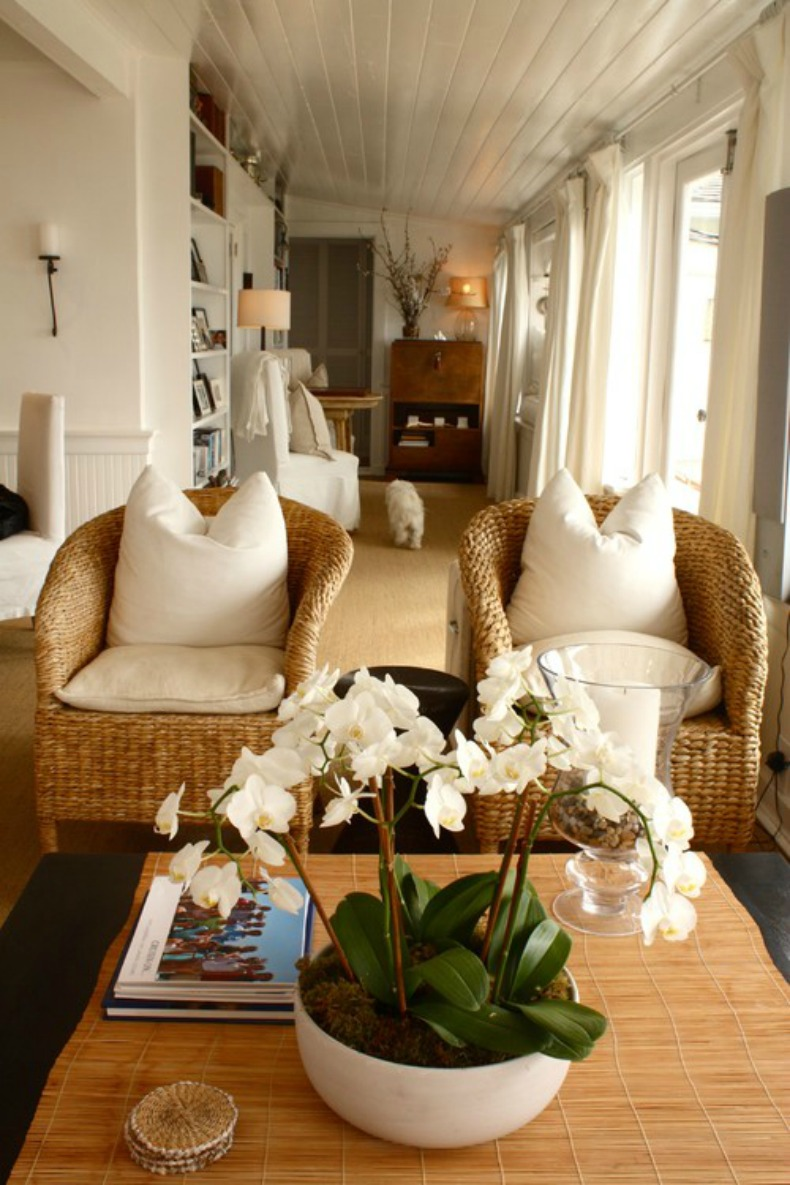 Coastal wicker club chairs with white cushions