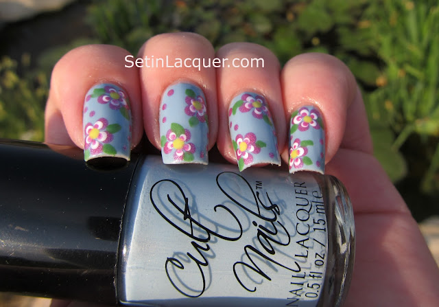 Flower with dotting tools nail art
