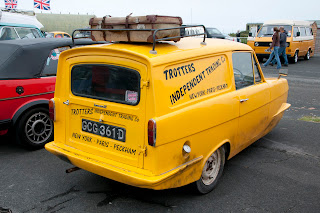 Trotters independent traders yellow three wheeler