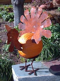 pumpkin with metal turkey head tail and legs attached