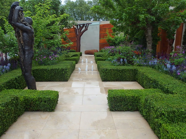 Chris Beardshaw's Healthy Cities Garden in the rain at Chelsea Flower Show