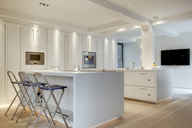 Picture of modern kitchen with minimalist white furniture