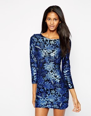 http://www.asos.com/es/Vestido-ajustado-de-lentejuelas-de-Club-L/8sdj0/?iid=4345323&SearchQuery=dress%20sequins&sh=0&pge=0&pgesize=204&sort=-1&clr=Navy+floral+sequins&totalstyles=292&gridsize=3&mporgp=L0NsdWItTC9DbHViLUwtU2VxdWluLUJvZHljb24tRHJlc3MvUHJvZC8.