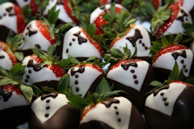 Strawberries dipped in dark and white chocolate to look like shirts and jackets