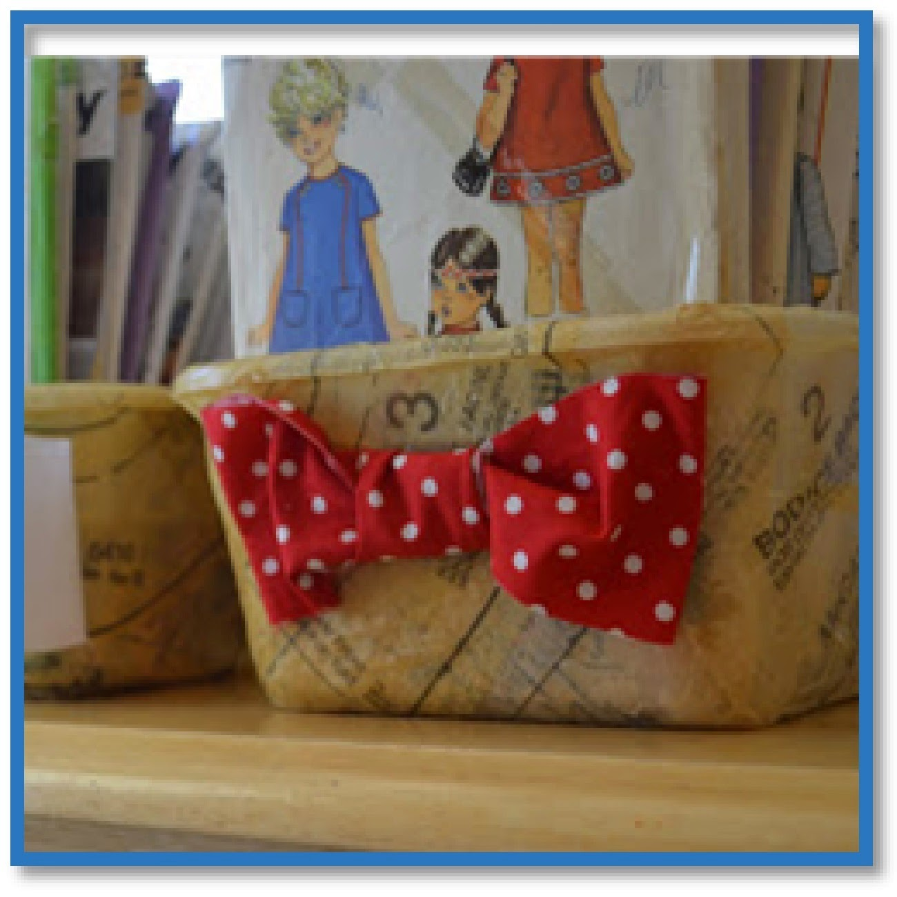 boxes decoupaged with sewing patterns