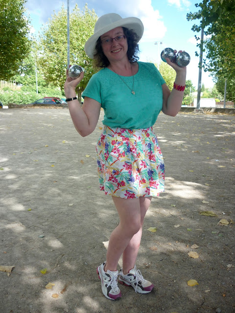 Holding Boules, wearing Hawaiian Print Shorts & Embroidery Top | Petite Silver Vixen