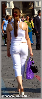 Lady in white pants on the street