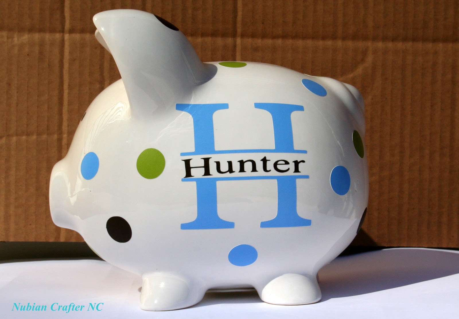 Nubian crafter designs personalized piggy bank - Coin banks for boys ...