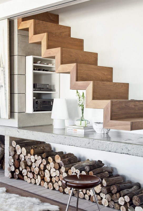Wooden staircase above the fireplace