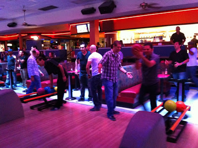 Group of people at the bowling alley lane