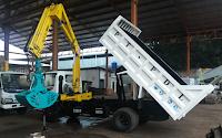 clampshell bucket dump truck crane