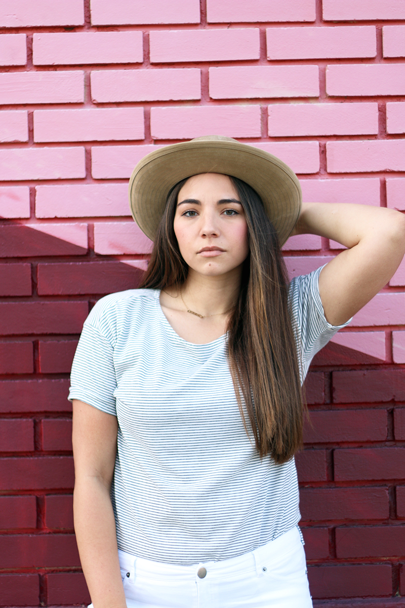 jcrew hat and long brunette hair