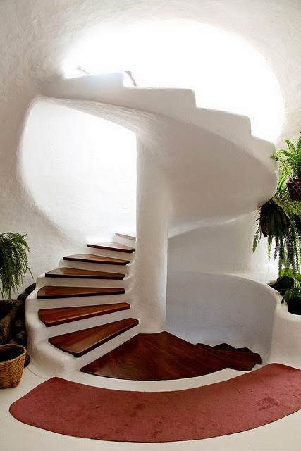wood spiral stairs with concrete