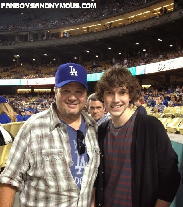 Comedy actor Neil Flynn photobombs a family picture at an LA ball game