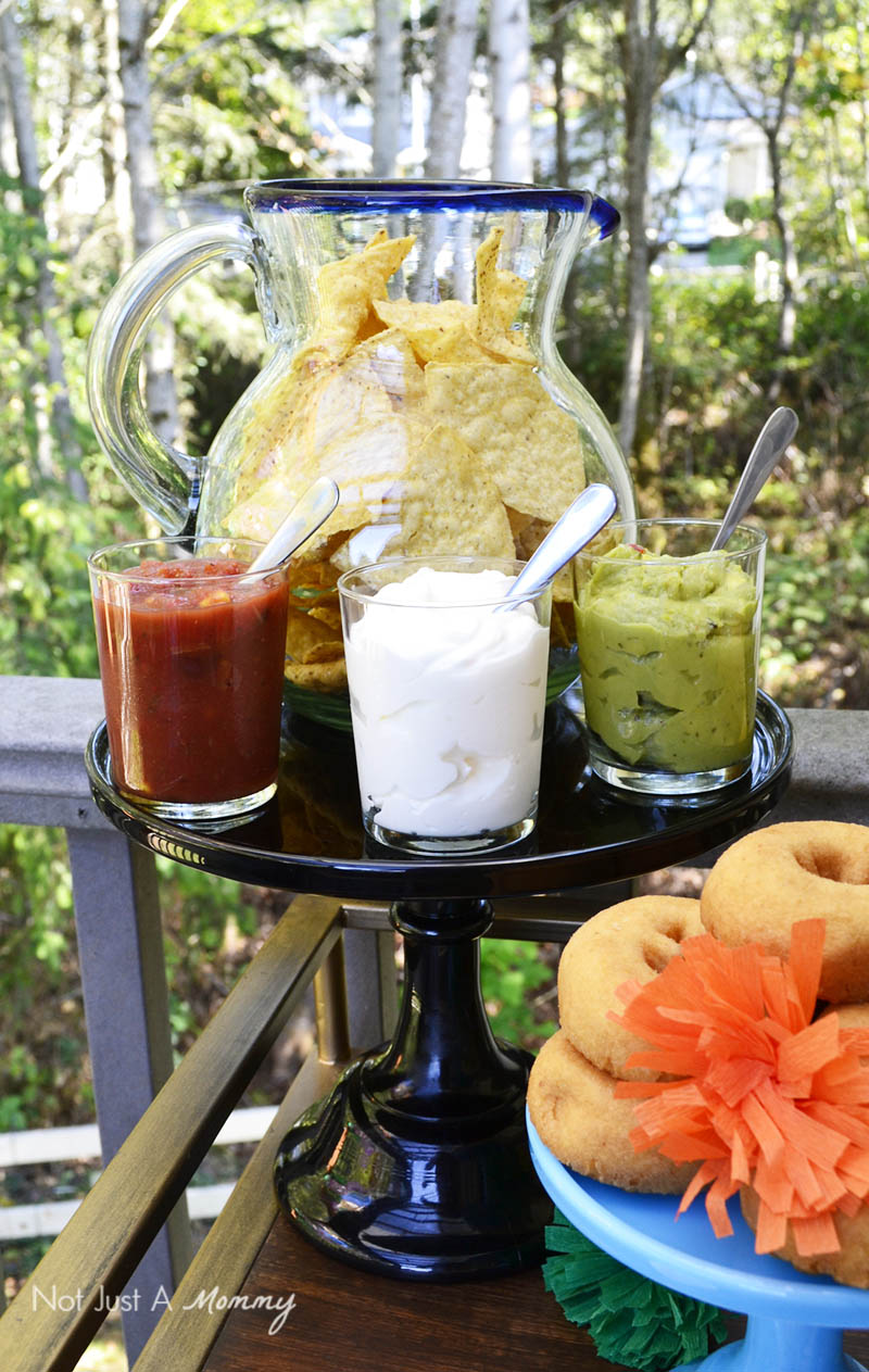 Serve chips in a colorful pitcher for a Día De Los Muertos Crafternoon Party