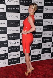 Kate Upton shows off her curves in an orange dress at Samsung Galaxy Note 10.1 Launch Event
