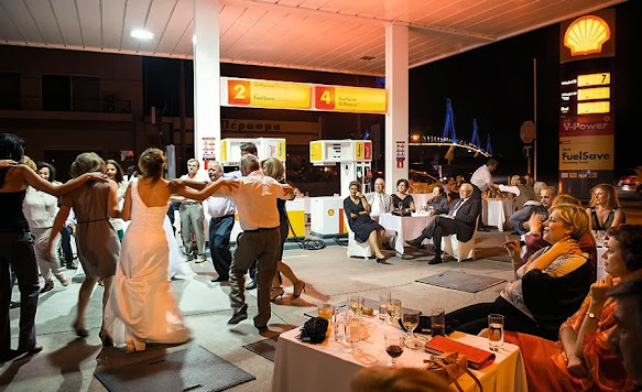 A dangerous act: observe the wedding guest smoking a cigarette on the forecourt