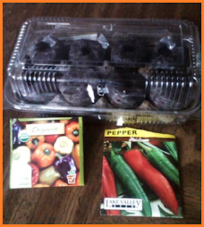 Rectangular clear plastic container holding 8 pellets within portions egg carton.  Seed packages on bottom: Organic purple, yellow, white, red, and orange bell peppers, and heirloom Anaheim chile peppers.