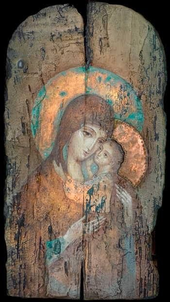 An Icon of the Virgin Mary and Jesus, painted on a wooden panel