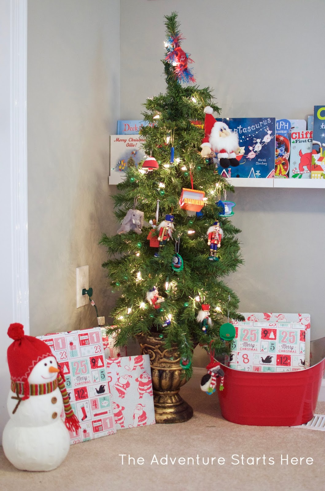Tree (similar)  Red Bucket (similar) Soldier Ornaments (home Goods)  Dunkin  Donuts