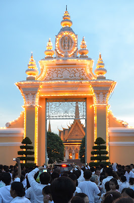 Return of body of King Norodom Sihanouk, crowd at Victory Gate of the Royal Palace, Phnom Penh, Cambodia