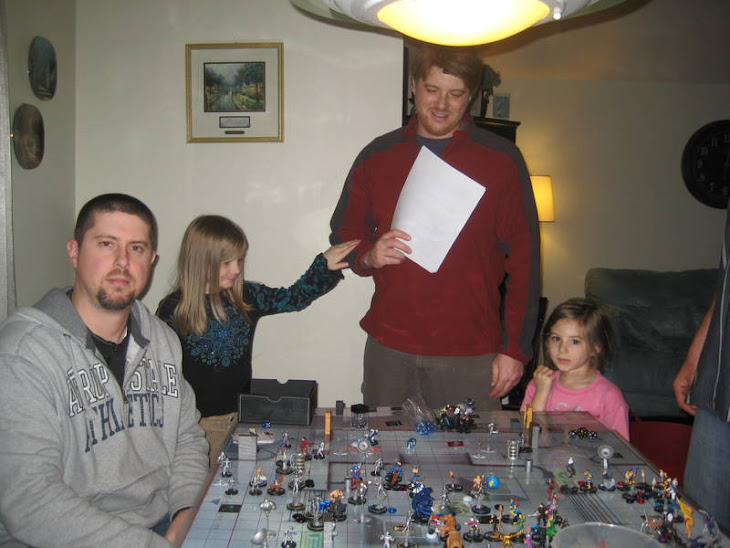 "Arlo and James at one of our ""HUGE"" Heroclix battles"