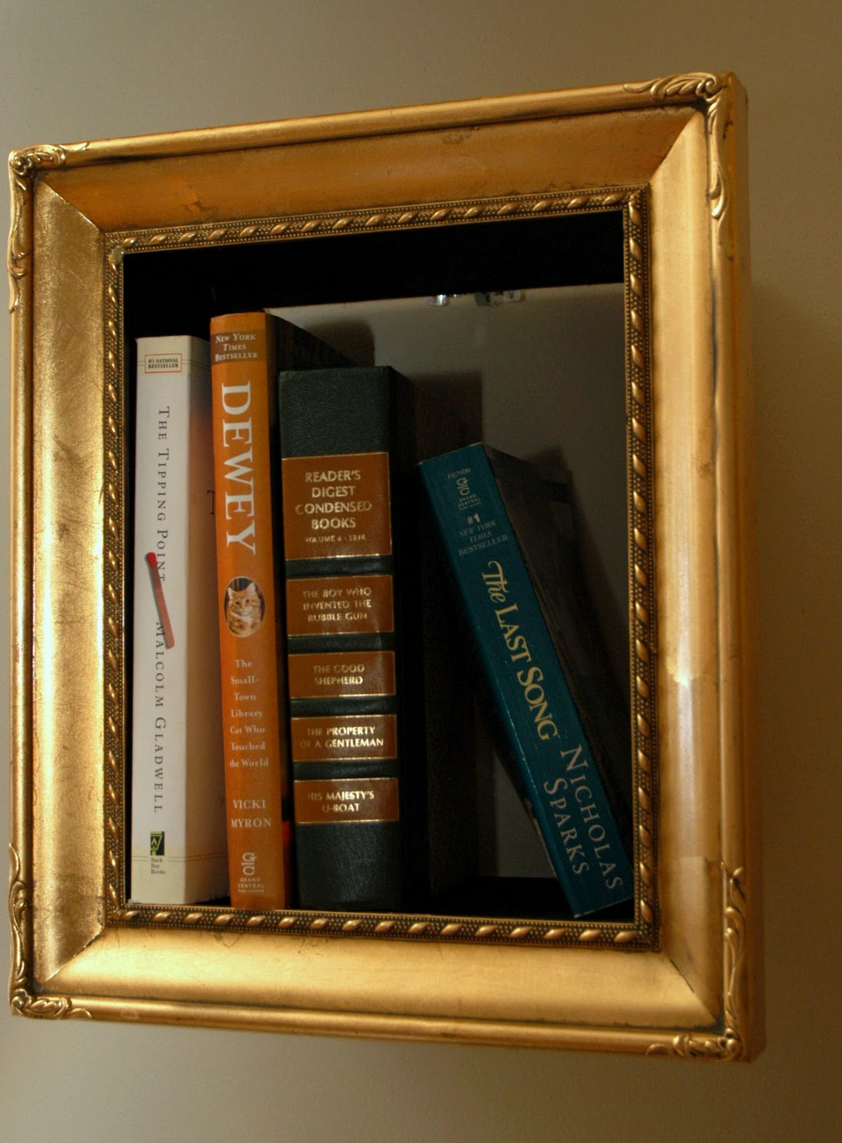 Change of scenery jen and chads place living room unveil small pieces of wood were added to the backs of old frames creating shelves for additional storage we arranged the framed shelves in an asymmetrical jeuxipadfo Gallery