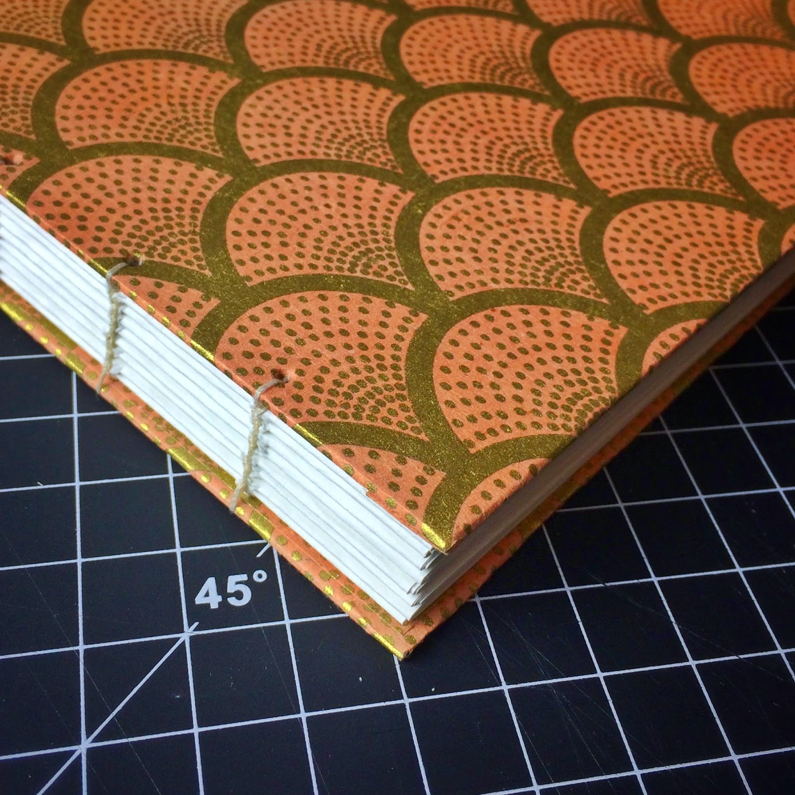 Hand binding wedding guest book using coptic binding method