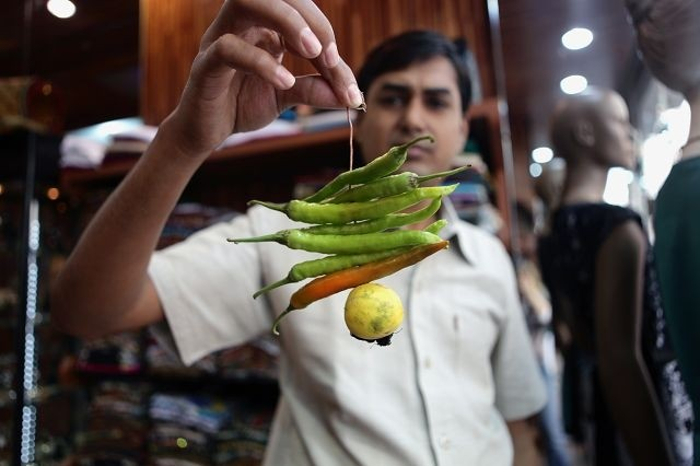 Science behind chillies and lemon tied on a thread on entrances.