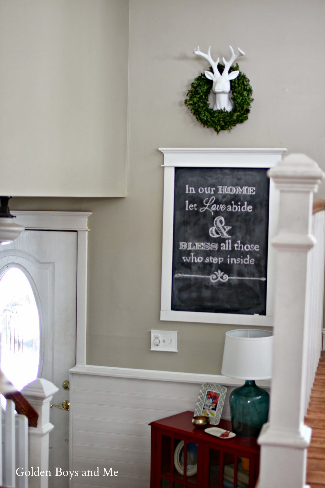 chalkboard art in entryway with white deer head and boxwood wreath-www.goldenboysandme.com