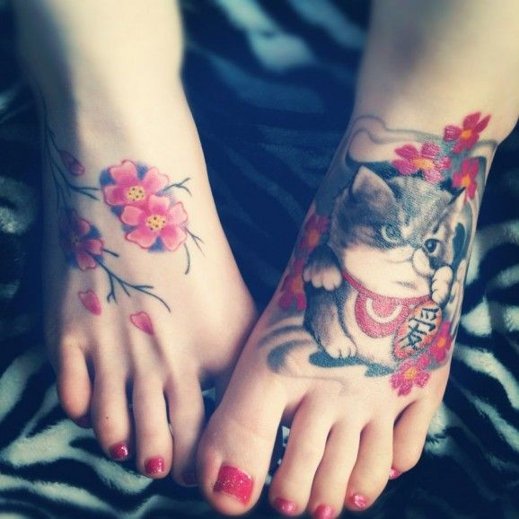 Cute cat with cherry blossom tattooo on feet