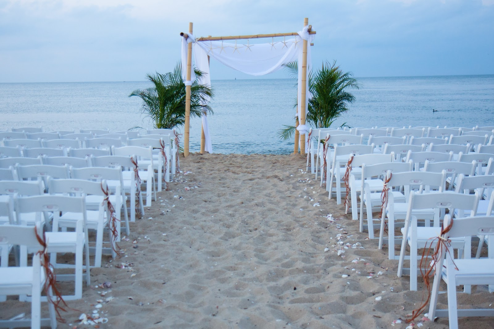 Sunrise party rental tent rental chairs rental tables for Cheap beach decorations for the home